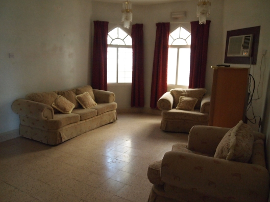 "my living room, or what the Omanis call a ""lounge""... it needs paint, new furniture, and some warming up:-)"