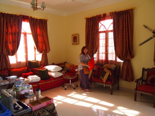 Marcia and her goods in Ray's majlis (room for entertaining guests)
