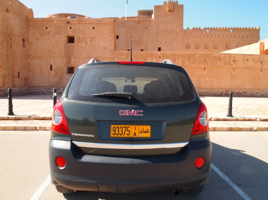 the rear view of my GMC Terrain sitting in front of Jabrin Fort