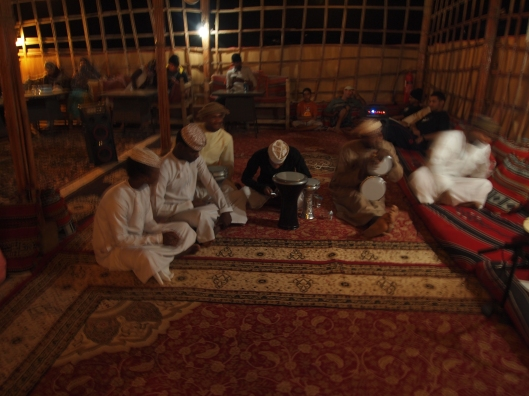 Bedouins play music for the guests in the communal hut