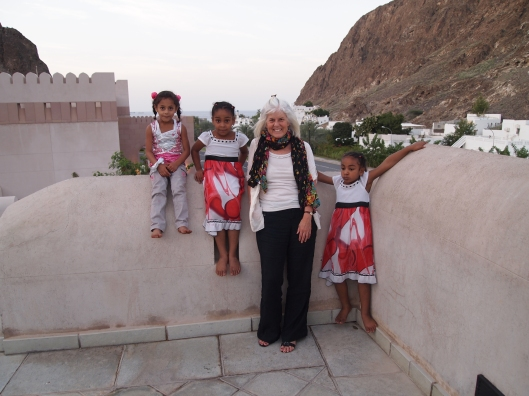 me with a bunch of little friends at the Muscat Gate Museum