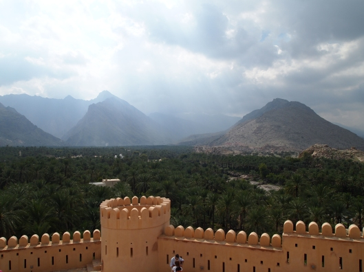 the view of the date palm plantations and the Hajar Mountains from Nakhal Fort