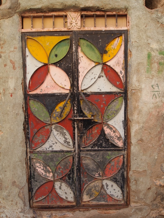 a painted door in the village of misfat