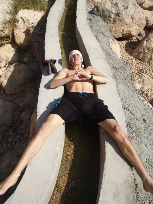 Adam stretches out over a falaj