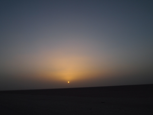 the sun sets over the Empty Quarter