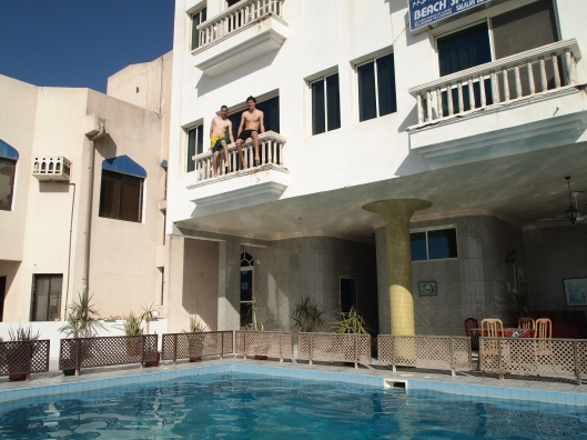 boys on the balcony, preparing to jump