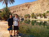 the boys at the entrance to wadi bani khalid in oman