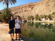 the boys at the entrance to wadi bani khalid in oman