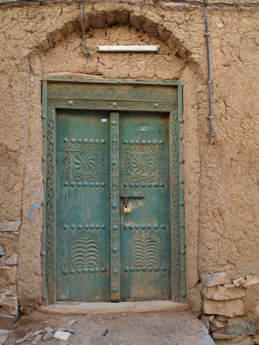 a carved door in the old village of Al Hamra