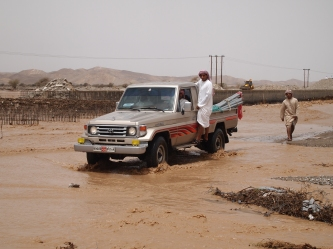 some intrepid Omanis dare to cross the wadi of all wadis near Ibri, Oman