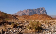 the 21 Bronze Age tombs of Al Ayn with the jagged, comb-shaped Jebel Misht behind ~ Oman