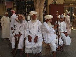 Omani men at Nizwa souq in Oman