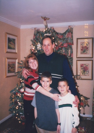 Sarah, Alex and Adam in front, Mike in back, in our house in Oakton, VA