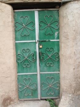 a green door in Misfat Al Abriyyen, Oman