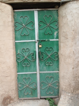 a green door in Misfat Al Abriyyen, Oman