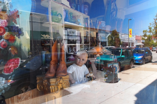 reflection in a shop window in Carytown, Richmond, Virginia