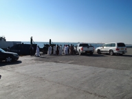 Cars line up for the ferry at one end of the dock
