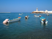 colorful fishing boats in Sur, Oman