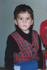 Adam wearing his red plaid Christmas vest