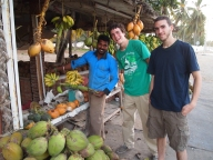 Adam and Alex talk to the Bangladeshi vendor about bananas in Salalah
