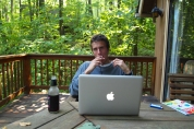 Adam at Deep Creek Lake this summer, on his MacBook Pro