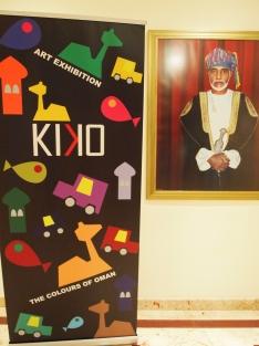 the Kiko exhibition poster next to a picture of the Sultan at the Crowne Plaza