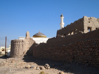the wall of the old town and a new mosque dome & minaret