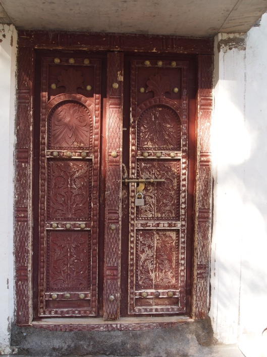 and a carved wooden door