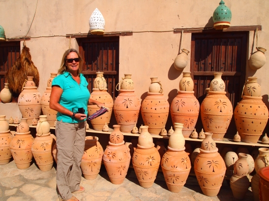 Anne trying to decide on which pottery to buy