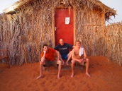 Alex, Mike and Adam in front of our hut