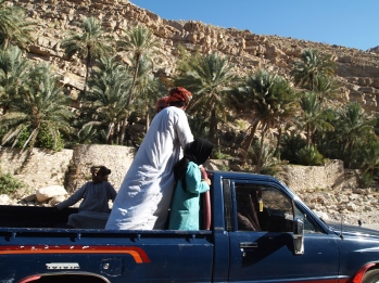 trucks of Omanis leaving Wadi Bani Khalid