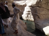 Omanis leap over the stream
