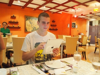 Adam checks out the iPad menu at The Silk Route