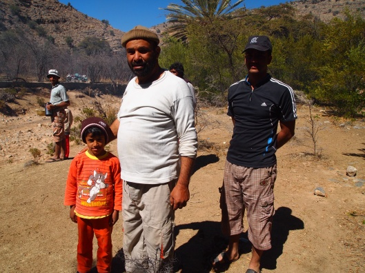 This man and his grandson, Abdullah, tell us directions