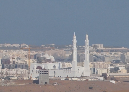a new mosque under construction that looks like it's being built on a sand dune ???