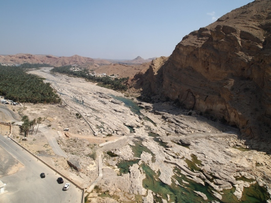 looking down into the wadi from the top of the dam