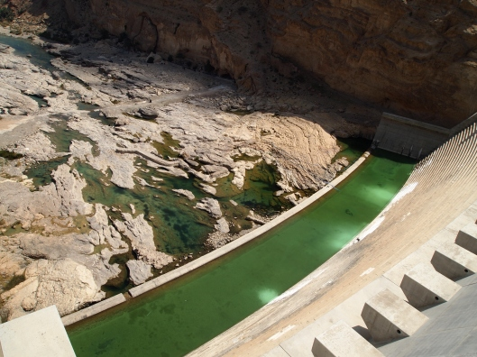 the pool at the bottom of the dam, as seen from above