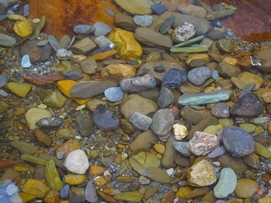 a little pool full of colorful rocks