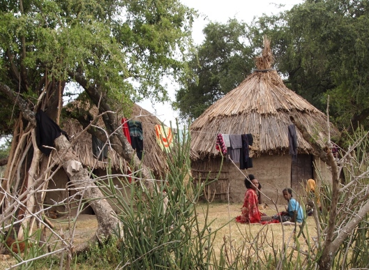 tukul hut and family near Lake Langano, Ethiopia