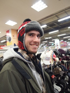 Alex tries on hats at Home Plus in Daegu, South Korea