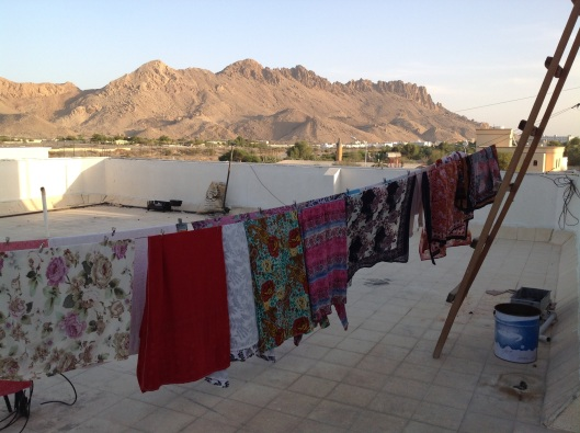 my Omani neighbors' wash hung out to dry on the roof