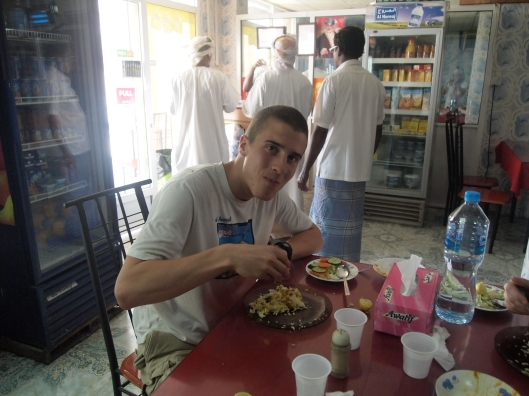 My son Adam eats with his hands, Omani style.