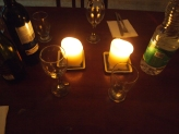 Candles and a table set for 3
