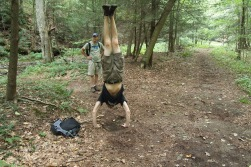 Alex does a handstand at Swallowtail Falls in Maryland