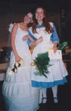 Sarah playing the part of Alice in Wonderland in high school