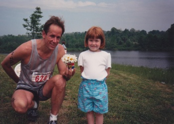 Mike gives Sarah flowers after finishing his triathlon