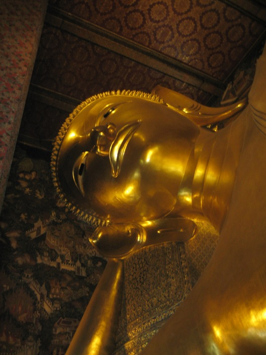 Looking up at the huge Reclining Buddha in Bangkok, Thailand