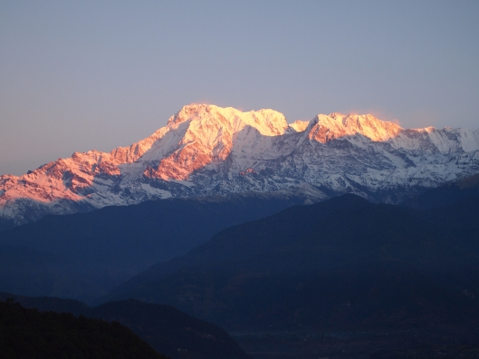 Sunlight at sunrise over the Annapurna Range in Pokhara, Nepal