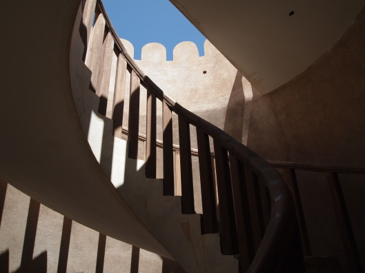 climbing up the watchtower at Wekan in Oman