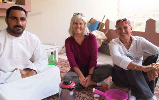 the Omani photographer/farmer, me and Mario, sharing apples, dates and coffee